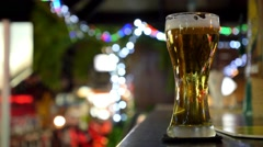Glass of Light Beer on Bar Counter in Pub. Closeup Stock Footage