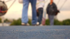 Children and parents having fun on playground in park, selective focus. - stock footage