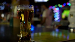 Draft Pint of Beer on a Bar Counter Stock Footage