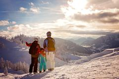 Happy family in winter clothing at the ski resort, winter time Stock Photos