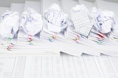 Bankruptcy of house and paper ball on pile of paperwork Stock Photos