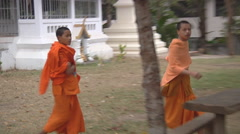 Buddist children in the monastery in Luang Prabang, Laos Stock Footage