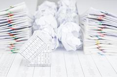 Bankruptcy of house have group of paper ball between paperwork Stock Photos