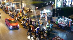 People walk at crowded sideway, night asian city, food vendors, timelapse Stock Footage