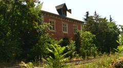 Old trainstation with trees 1 Stock Footage