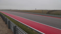 F1 car speeds by at COTA, Circuit of the Americas Stock Footage
