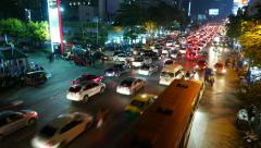 Traffic gathering to large congestion, wide night road, time lapse Stock Footage
