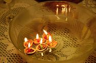 Stock Photo of glass bowl with floating candles and shells nuts