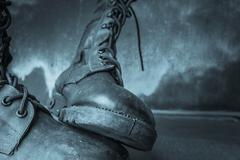 Combat boot on wooden Stock Photos