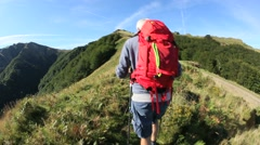 Trekker walking on top of Pyrenees mountains, Basque Country Stock Footage