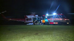 Ambulance loads critical patient from Helicopter Stock Footage