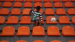 Boy unhappy football team missed a goal, fan boy throws the ball on the stadium Stock Footage