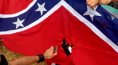 (Clip 2 of 7) Confederate flag protest and riot (flag burning) Stock Footage