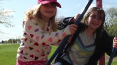 Young girls on a swing Stock Footage