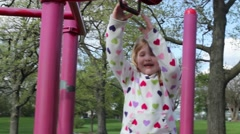 Young girls playing in the park Stock Footage