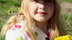 Cute young girl playing Stock Footage