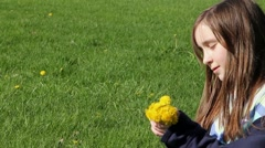 Happy young girl picking flowers Stock Footage