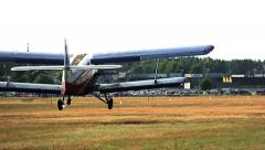 Agriculturial airplane landing in a field near the forest, the forest airfield Stock Footage