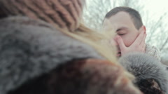 Woman touching boyfriend cheeks - stock footage