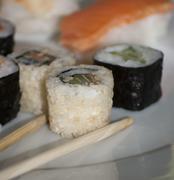 Tasty Japanese sushi set on white plate - stock photo