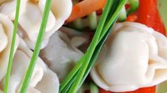 Dumplings served on green plate Stock Footage