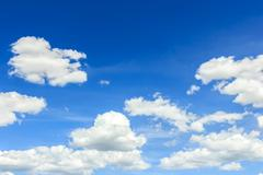 Clouds on the blue sky Stock Photos