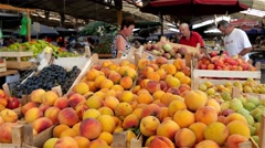 Peaches and other fruits on stall, market place, people are buying fruits, 4k Stock Footage