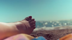 Static shot of woman foot on the beach Stock Footage