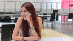 Portrait of thai adult beautiful girl Answer the phone and smile. Stock Footage