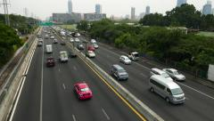 Car traffic on expy road run through Bangkok city, straight arterial way Stock Footage