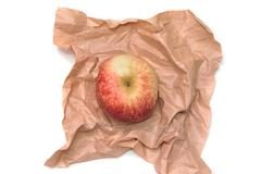 Apple is wrapped in the paper Stock Photos