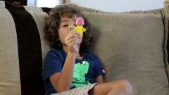 Sweet little boy eating delicious ice cream at home Stock Footage