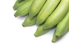 green banana bundle on a white background - stock photo