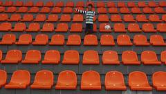 Fan boy sick in the stadium for the team and enjoys a goal scored by his team Stock Footage