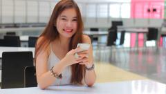 Portrait of thai adult beautiful girl using her smart phone and smile. Stock Footage