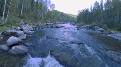 Forest mountain river (the camera pans down stream) Stock Footage
