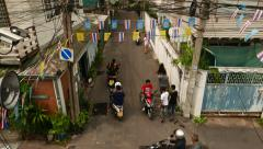 Empty alley being lively with people walk and motorcycle ride through. Top view Stock Footage