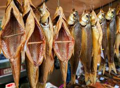 Smoked fish ready to sale at the local market - stock photo