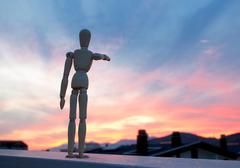 Wooden dummy pointing with his finger towards the horizon Stock Photos