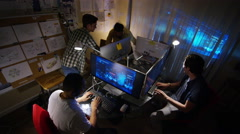 4K Young creative computer design team working together in dark office. - stock footage