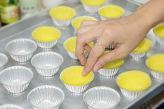 Prepare cupcake liners in tray before baking Stock Photos