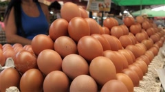 Eggs standing on stall at the market place. Food product from poultry farm. 4k Stock Footage