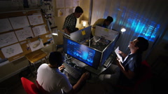 4K Young creative computer design team working together in dark office. Stock Footage