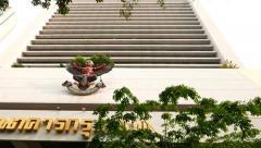 Bangkok bank building facade from low angle, garuda symbolising royal warrant Stock Footage