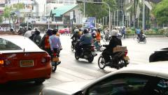 Pack of motorcycles rush from junction, telephoto view from side behind Stock Footage