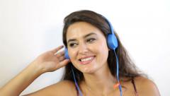 Pretty, beautiful woman listening to music with headphones. clouse-up. Stock Footage