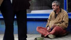 Jobless in the street asking the charity: waiting for the aid of people Stock Footage
