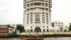 White condominium tower on the riverside, view from water, parallax tilt down Stock Footage