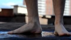 Trampled barefoot in a puddle Stock Footage