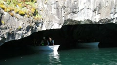 Boat will pass out of the cave. Stock Footage